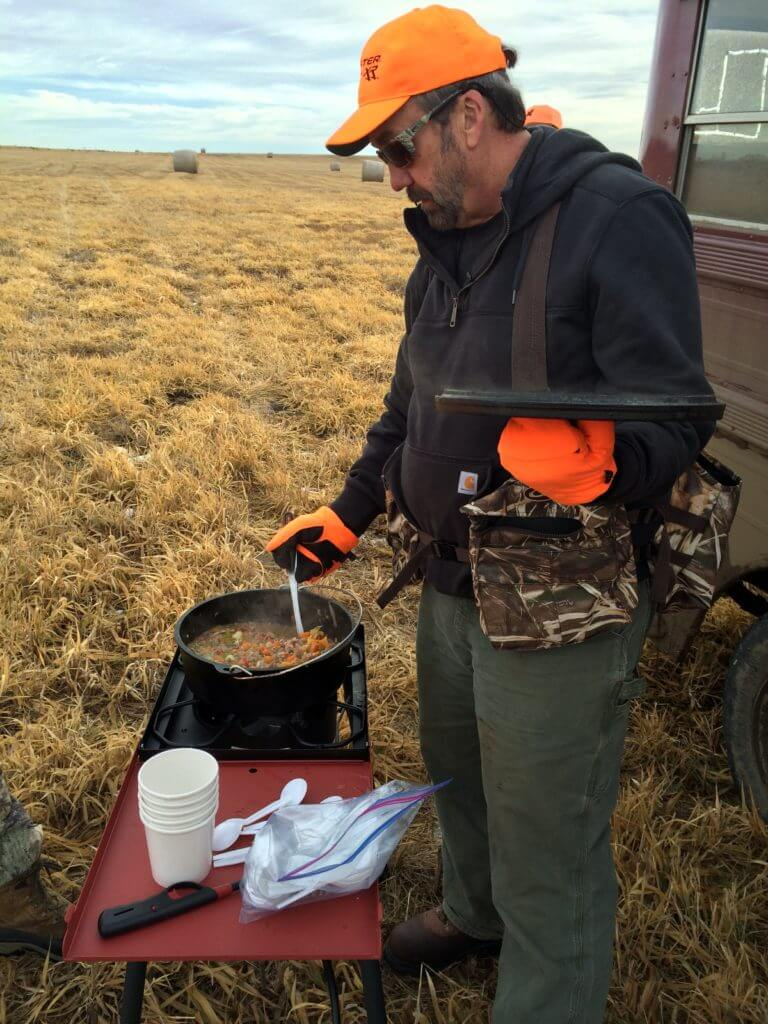 The Sporting Chef making Pheasant Stew in the field.