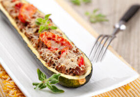 Zucchini halves stuffed with venison and vegetable