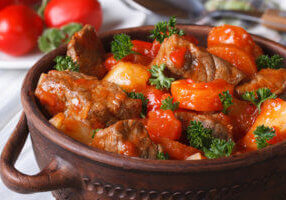 stew in tomato sauce with vegetables close up in a pot. horizontal