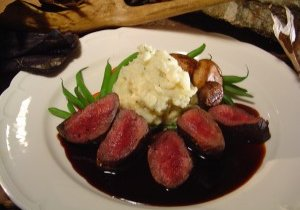 Pan-Seared Venison Medallions with Balsamic Berry Sauce