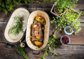 roasted venison with herbs and vegetables